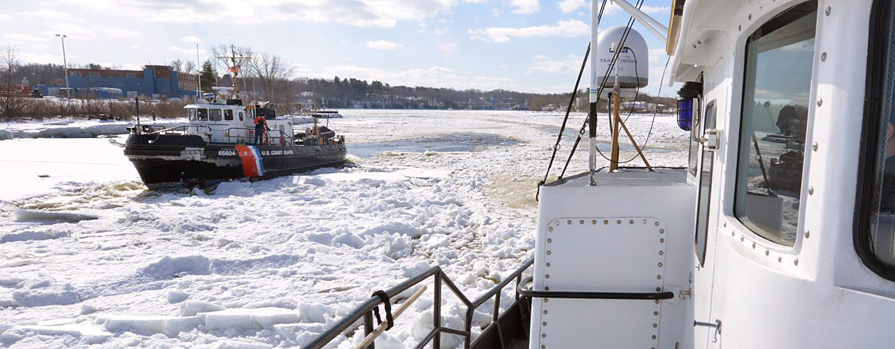 Coast Guard cutters breaking ice on the Penobscot River, Maine.